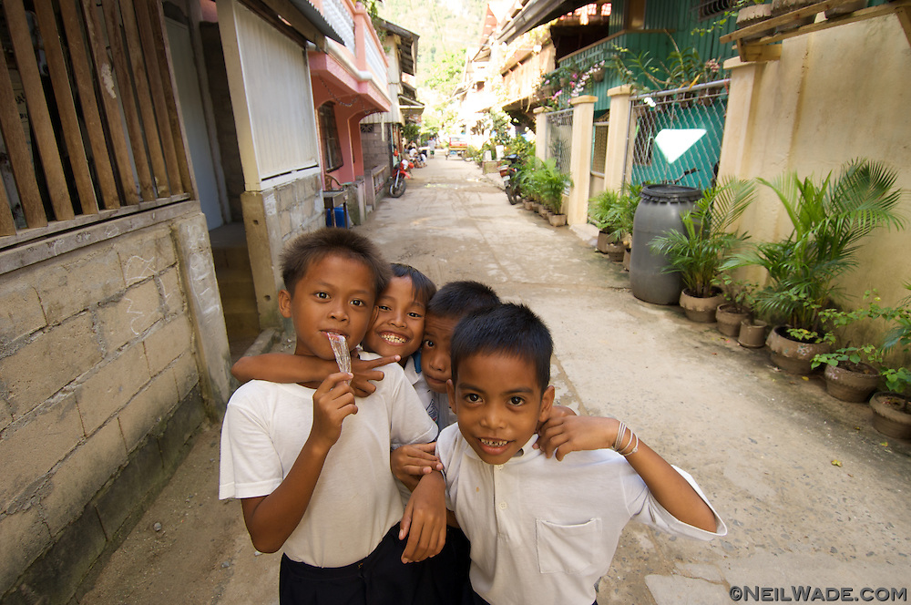 Some local Filipino children pose for the camera in El Nido Town, Palawan, Philippines.