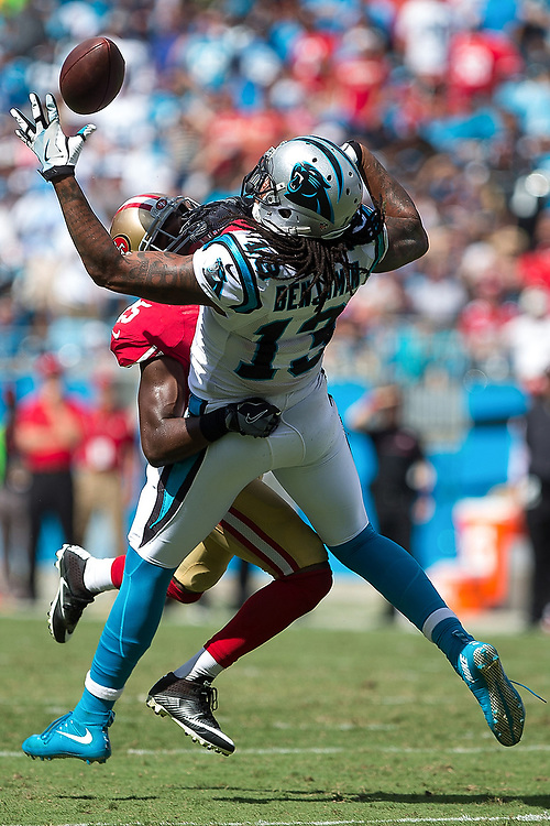 Carolina's Kelvin Benjamin (13) catches a tipped ball while being tackled by San Francisco's Jimmie Ward (25). <br /> San Francisco 49ers vs Carolina Panthers at Bank of America Stadium in Charlotte, N.C., on Sunday, Sept. 18, 2016. <br /> Zach Bland Photo