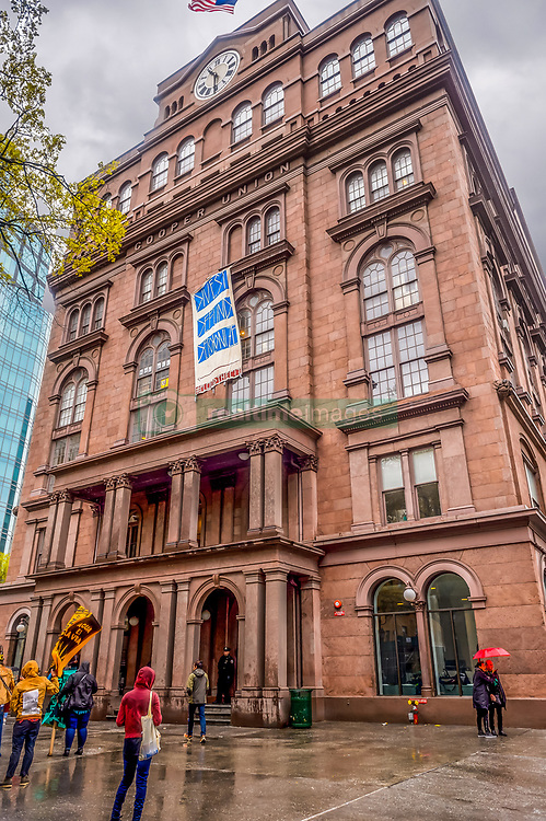 April 25, 2017 - New York, NY, United States - Hundreds turned out in the rain for a prayerful rally on April 25, 2017; at the historic Cooper Union to protest Citibank's annual shareholder meeting. The Indigenous-led, and ally supported event sent a strong message to Citibank and its shareholders: honor Indigenous rights, stop extractive energy investment now, and invest in  a Just Transition, and renewable energy towards a climate-stable future, calling to Divest, Defund and Decolonize their investments. (Credit Image: © Erik Mcgregor/Pacific Press via ZUMA Wire)