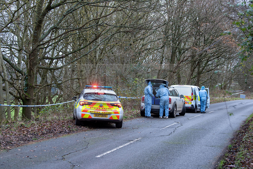 "© Licensed to London News Pictures. 07/12/2019. Gerrards Cross, UK. Forensic investigators gather evidence as London's Metropolitan Police Service searches woodland in Gerrards Cross, Buckinghamshire. Police have been in the area conducting operations since Thursday 5th December 2019 and are searching two areas on Hedgerley Lane. In a press statement a Metropolitan Police spokesperson said ""Officers are currently in the Gerrards Cross area of Buckinghamshire as part of an ongoing investigation.<br /> ""We are not prepared to discuss further for operational reasons.""<br /> Photo credit: Peter Manning/LNP"