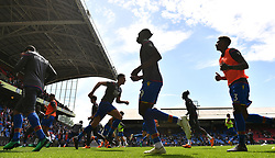 Crystal Palace players warming up before the Premier League match at Selhurst Park, London.