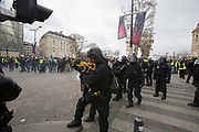 December, 8th, 2018 - Paris, Ile-de-France, France: Riot policeman with rubber bullet rifle gun on Champs Elysees. The French 'Gilets Jaunes' demonstrate a fourth day. Their movement was born against French President Macron's high fuel increases. They have been joined en mass by students and trade unionists unhappy with Macron's policies. Nigel Dickinson