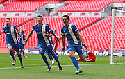 Glossop Tom Bailey celebrates his opening goal during the FA Vase Final between Glossop North End and North Shields at Wembley Stadium, London, England on 9 May 2015. Photo by Phil Duncan.