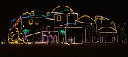 Colored lights create an outline of a Bethlehem village at the Way of Lights holiday light display at the National Shrine of Our Lady of the Snows in Belleville on December 3, 2019. This is the 50th anniversary of the annual light display, which runs from 5 pm to 9 pm through December 31. There are also indoor activities including a Christmas tree room, decorated wreaths, and children's craft activities. Carriage rides are available at the Way of Lights.<br />Photo by Tim Vizer