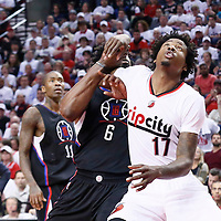 25 April 2016: Portland Trail Blazers center Ed Davis (17) vies for the rebound with Los Angeles Clippers center DeAndre Jordan (6) during the Portland Trail Blazers 98-84 victory over the Los Angeles Clippers, during Game Four of the Western Conference Quarterfinals of the NBA Playoffs at the Moda Center, Portland, Oregon, USA.