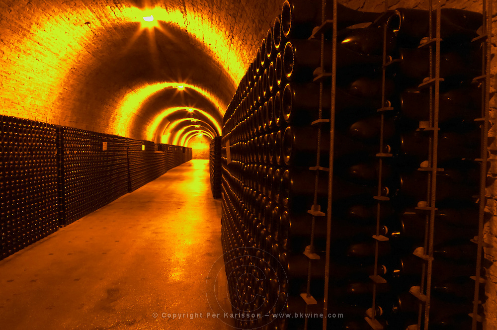 In the underground winecellar that is an old chalk quarry: thousands and millions of bottles aging, Champagne Ruinart, Reims, Champagne, Marne, Ardennes, France, low light grainy grain