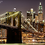 The Bridge and the skyscrapers of Manhattan across the East River at dusk.