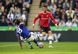 Leicester City's Daniel Amartey and Manchester United's Cristiano Ronaldo (right) battle for the ball during the Premier League match at the King Power Stadium, Leicester. Picture date: Saturday October 16, 2021.
