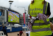 A Manly supporter watching the 2008 Rugby League Grand Final on a big screen set up outside Olympic Stadium. Sydney, Australia