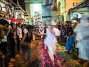 20 OCTOBER 2015 - YANGON, MYANMAR: Firewalking on Ashura at Punja Mosque in Yangon. Ashura commemorates the death of Hussein ibn Ali, the grandson of the Prophet Muhammed, in the 7th century. Hussein ibn Ali is considered by Shia Muslims to be the third imam and the rightful successor of Muhammed. He was killed at the Battle of Karbala in 610 CE on the 10th day of Muharram, the first month of the Islamic calendar. According to Myanmar government statistics, only about 4% of the population is Muslim. Many Muslims have fled Myanmar in recent years because of violence directed against Burmese Muslims by Buddhist nationalists.   PHOTO BY JACK KURTZ