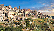 """Vew of """"la Gravina"""" ravine and the Sassi of Matera, Basilicata, Italy. A UNESCO World Heritage site.<br /> <br /> The area of Matera has been occupied since the Palaeolithic (10th millennium BC) making it one of the oldest continually inhabited settlements in the world. <br /> The town of Matera was founded by the Roman Lucius Caecilius Metellus in 251 BC and remained a Roman town until  was conquered by the Lombards In AD 664 becoming part of the Duchy of Benevento.  Matera was subject to the power struggles of southern Italy coming under the rule of the Byzantine Roman, the Germans and finally Matera was ruled by the Normans from 1043 until the Aragonese took possession in the 15th century. <br /> <br /> At the ancient heart of Matera are cave dwellings known as Sassi. As the fortunes of Matera failed the sassy became slum dwelling and the appalling living conditions became be the disgrace of Italy. From the 1970's families were forcibly removed from the Sassi and rehoused in the new town of Matera. Today tourism has regenerated Matera and the sassi have been modernised and are lived in again making them probably the longest inhabited houses in the world dating back 9000 years."""