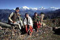 Gurkha Lance Cpl Janga Thapa photographed at his hilltop village with his two young wives.He married them after his first two wives died of Typhoid.Photographed by Terry Fincher 1969
