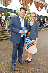 Trainer PAUL MESSARA and his wife ALICE at the Goffs London Sale held at The Orangery, Kensington Palace, London on 12th June 2016.