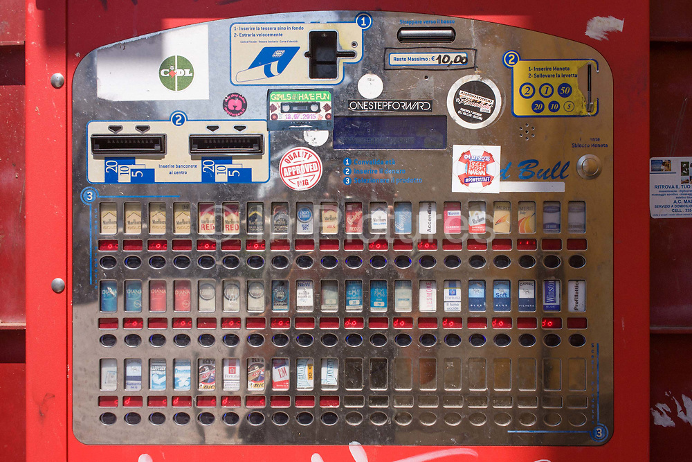 Detail of an Italian cigarette dispenser in a Bassano street. Various brands and strengths of nicotine can be bought on the street in Italy.  Under Italian law, sales are prohibited under to 18s and machines must contain an electronic device to verify the age of buyer.