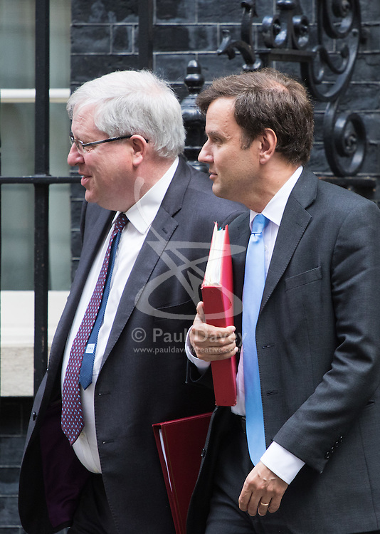 Downing Street, London, June 14th 2016. Transport Secretary Patrick McLoughlin, left, and Chief Secretary to the Treasury Greg Hands leave 10 Downing Street after attending the weekly cabinet meeting.