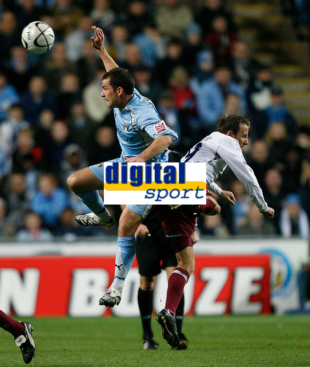 Photo: Steve Bond.<br />Coventry City v West Ham United. Carling Cup. 30/10/2007. Michael Doyle (L) and Lee Bowyer (R) contest a high ball