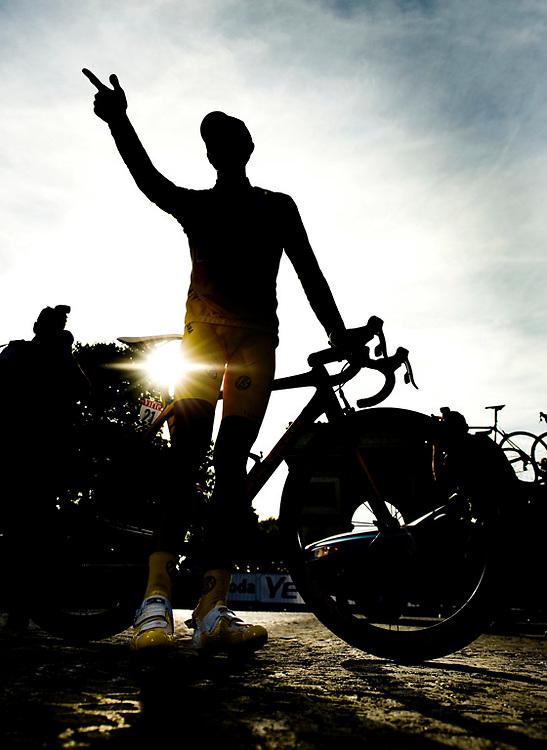 """France, Paris, 26-07-2009.<br /> Cycling, Tour de France.<br /> Alberto Contador, the winner of the Tour de France, makes his """"pistolero"""" sign during his lap of honor down the Avenue des Champs-Elysées in Paris.<br /> Photo: Klaas Jan van der Weij"""