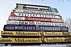 March 27, 2019 - Ankara, Turkey - Signboards of foreign language courses are seen on the facade of a commercial building in the city centre. (Credit Image: © Altan Gocher/ZUMA Wire)