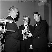 24/01/1962.01/24/1962.24 January 1962.Inter-University Debating Competition held at Trinity College Dublin. Mr. Donald Smylie, Night Editor, Irish Times (left), presents the trophy to the Q.U.B. team, Mr. John Murtagh (right), and Mr. Bowes Michael Egon (centre).