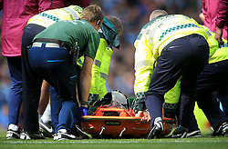 Manchester City goalkeeper Ederson is stretchered off the pitch by medical staff