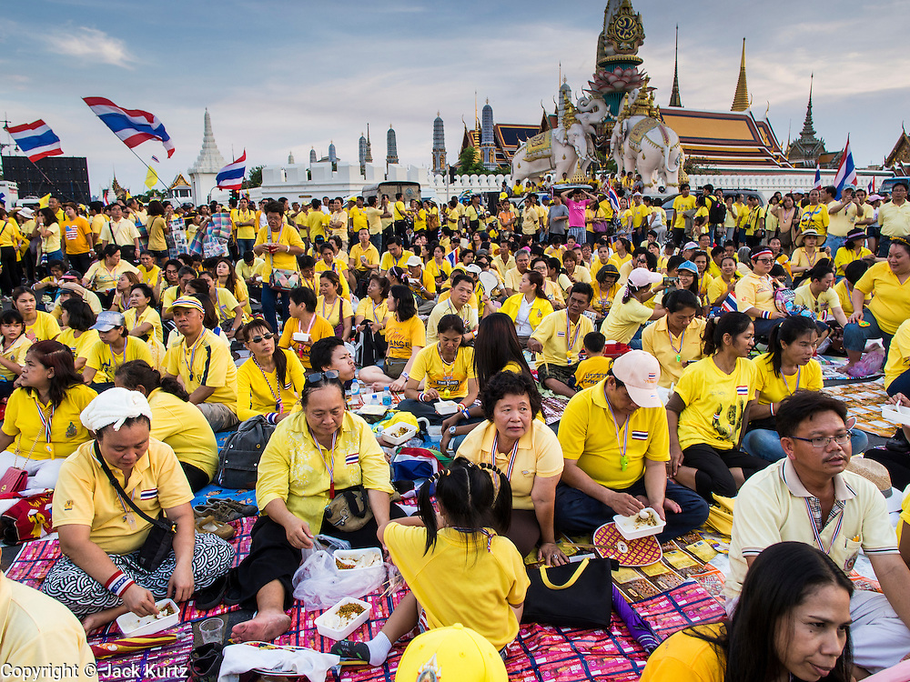 05 MAY 2104 - BANGKOK, THAILAND: Anti-government supporters of the Thai monarchy pack Ratchadamnoen Ave in front of Sanam Luang. Thousands of Thais packed the area around Sanam Luang and the Grand Palace Monday evening for a special ceremony to mark Coronation Day, which honored the 64th anniversary of the coronation of Bhumibol Adulyadej, the King of Thailand. Many of the people also support the anti-government movement led by Suthep Thaugsuban. Most of the anti-government protesters are conservative supporters of the monarchy.    PHOTO BY JACK KURTZ