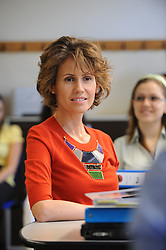 File photo - Syrian First Lady Asma Al Assad meets with students and teachers as she visits Vienna Business School in Vienna, Austria, on April 28, 2009. The Syrian presidential couple is on a 2 day visit to Austria. Syria's British-born first lady Asma Assad has begun treatment for breast cancer. The Syrian presidency posted on its Facebook page a photo of President Bashar Assad sitting next to his wife in a hospital room. Photo by Ammar Abd Rabbo/ABACAPRESS.COM