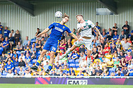 AFC Wimbledon forward Aaron Pressley (19) battles for possession in the air with Plymouth Argyle defender Dan Scarr (6) during the EFL Sky Bet League 1 match between AFC Wimbledon and Plymouth Argyle at Plough Lane, London, United Kingdom on 18 September 2021.