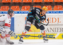 21.02.2021, Keine Sorgen Eisarena, Linz, AUT, EBEL, EHC Liwest Black Wings Linz vs iClinic Bratislava Capitals, 48. Qualifikationsrunde, im Bild v.l. Ryan Culkin (iClinic Bratislava Capitals), Dennis Yan (Steinbach Black Wings 1992) // during the bet-at-home ICE Hockey League 48th qualifying round match between EHC Liwest Black Wings Linz and iClinic Bratislava Capitals at the Keine Sorgen Eisarena in Linz, Austria on 2021/02/21. EXPA Pictures © 2021, PhotoCredit: EXPA/ Reinhard Eisenbauer