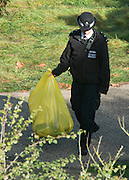 © Licensed to London News Pictures. 05/10/2014. Brentford, UK . A police officer holds a yellow bag. Police remove the body of Arnis Zalkains from Boston Manor Park today 5th October 2014. The body of a man, believed to be Latvian killer Arnis Zalkalns, was found in Boston Manor Park, Brentford, almost six weeks after the schoolgirl Alice Gross vanished.Arnis Zalkalns was prime suspect in the murder of 14-year-old Alice Gross.. Photo credit : Stephen Simpson/LNP