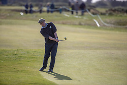 Actor Hugh Grant chunks his chip at the 16th hole during day two of the Alfred Dunhill Links Championship at Carnoustie Golf Links, Angus.