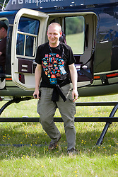 Paul Harknoll from Orbital goes up in a helicopter. Rockness, Saturday 13th June 2009..Pic © Michael Schofield. All Rights Reserved.