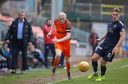 Dundee United's Willo Flood  and Falkirk's Joseph McKee. Dundee United 1 v 0 Falkirk, Scottish Championship played 14/4/2018 at Dundee United's stadium Tannadice Park.