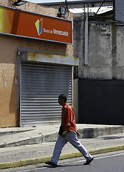 March 23, 2019 - Valencia, Carabobo, Venezuela - A man was past a closed bank of Venezuela, on university avenue. The bank that recently has been sanctioned by the government of the United States, within the measures of pressure against Maduro. (Credit Image: © Juan Carlos Hernandez/ZUMA Wire)