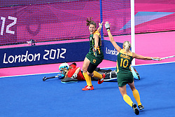 Dirkie Chamberlaine celebrates scoring the only goal for South Africa as they lose their opening match by 7 goals to 1 during the Women's Hockey match between South Africa and Argentina held at the Riverbank Stadium in the Olympic Park in London as part of the London 2012 Olympics on the 29th July 2012.Photo by Ron Gaunt/SPORTZPICS