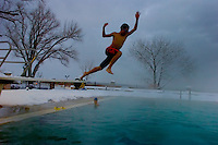 A child jumps into the hot spring fed pool during the cold of winter in Saratoga Spings Utah.