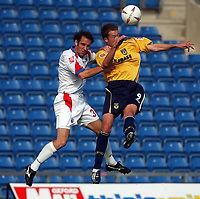 Photo: Daniel Hambury.Digitalsport<br /> Coca Cola League Two<br /> Oxford United V Rushden & Diamonds .  11/9/2004.<br /> <br /> <br /> Oxford United's Steve Bashamand Rushden & Diamonds' Peter Hawkins