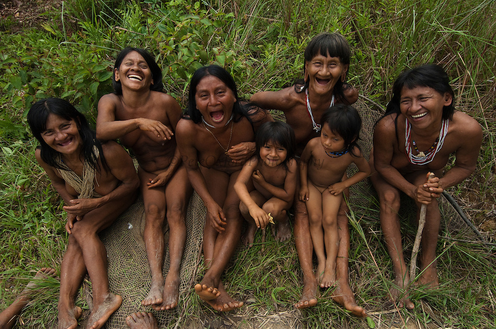 Huaorani sitting in the forest.<br /> Bameno Community. Yasuni National Park.<br /> Amazon rainforest, ECUADOR.  South America<br /> This Indian tribe were basically uncontacted until 1956 when missionaries from the Summer Institute of Linguistics made contact with them. However there are still some groups from the tribe that remain uncontacted.  They are known as the Tagaeri & Taromenane. Traditionally these Indians were very hostile and killed many people who tried to enter into their territory. Their territory is in the Yasuni National Park which is now also being exploited for oil.