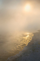 Steam from Firehole Lake illuminated in morning sun, Yellowstone National Park