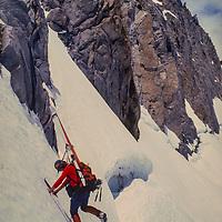Ski Mountaineer Michael Graber climbs around the U-Notch couloir on  the Palisade Glacier, Sierra Nevada, CA