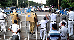 August 16, 2017 - Kolkata, West Bengal, India - Garment Industry workers protest March against GST in Kolkata on 16-8-2017. They specially poor tailors are march for minimum wages,social security and demand for 8 hours working time.The Garment workers march to Governor House and submit deputation but (Credit Image: © Sandip Saha/Pacific Press via ZUMA Wire)