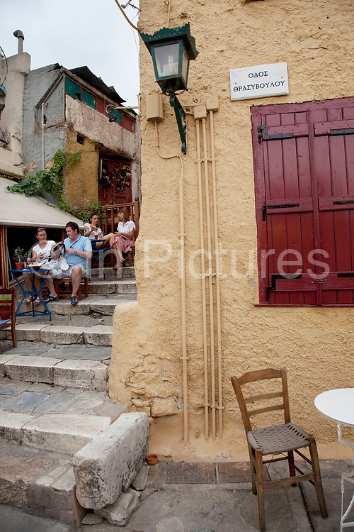Street of a taverna scene in Plaka. Plaka is the old historical neighborhood of Athens, clustered around the northern and eastern slopes of the Acropolis, and incorporating labyrinthine streets and neoclassical architecture. Plaka is built on top of the residential areas of the ancient town of Athens. It is known as the 'Neighbourhood of the Gods' due to its proximity to the Acropolis and its many archaeological sites. Athens is the capital and largest city of Greece. It dominates the Attica periphery and is one of the world's oldest cities, as its recorded history spans around 3,400 years. Classical Athens was a powerful city-state. A centre for the arts, learning and philosophy.
