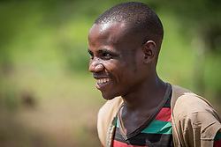 4 June 2019, Meiganga, Cameroon: 26-year-old CAR refugee Bahene Felix acts as community mobilizer in the Ngam refugee camp. In collaboration with the LWF, he oversees and guides the work of a group of CAR refugees trained by the Lutheran World Federation in modern farming techniques. By keeping a strict ratio of how many seeds to sow per hectare, and by sowing Cassava and Groundnut together, they are able to both increase harvests and retain soil fertility over a longer time. Supported by the Lutheran World Federation, the Ngam refugee camp, located in the Meiganga municipality, Adamaoua region of Cameroon, hosts 7,228 refugees from the Central African Republic, across 2,088 households.