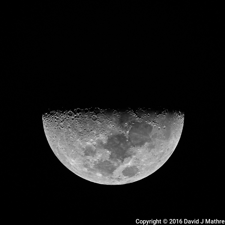 First Quarter Moon from the deck of the MV World Odyssey. Image taken with a Nikon One V3 camera and 70-300 mm VR lens (ISO 200, 300 mm, f/5.6, 1/250 sec). Field of View equivalent to an 810 mm lens on a 35 mm sensor camera.