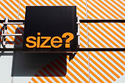 A sign for popular high street sports and streetwear retailer Size? on 26th August, 2021 in Manchester, United Kingdom. Size? is a popular sports-fashion retailer that specialises in footwear, frequently selling exclusive collaborations with popular footwear brands.