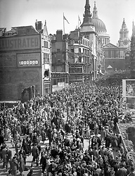 The joyous crowd surges across Ludgate-Hill after they had watched King George VI and Queen Elizabeth drive to and from St Paul's Cathedral.