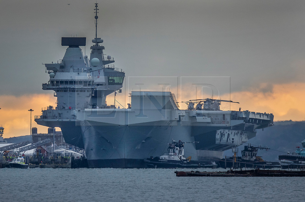 © Licensed to London News Pictures. 16/11/2019. Portsmouth, UK. HMS Prince of Wales, sister aircraft carrier of HMS Queen Elizabeth, at berth in Portsmouth for the first time. The Royal Navy's  latest aircraft carrier sailed from Rosyth dockyard to begin sea trials in September. The ship, which is 280 metres long and weighs 65,000 tonnes, is expected to commission into the Royal Navy in 2020. Photo credit: Peter Macdiarmid/LNP