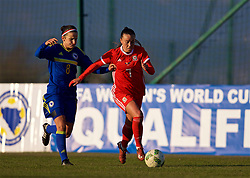 ZENICA, BOSNIA AND HERZEGOVINA - Tuesday, November 28, 2017: Wales' Natasha Harding and Bosnia and Herzegovina's Aida Hadžić during the FIFA Women's World Cup 2019 Qualifying Round Group 1 match between Bosnia and Herzegovina and Wales at the FF BH Football Training Centre. (Pic by David Rawcliffe/Propaganda)