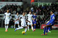 Wayne Routledge of Swansea city © has a shot at goal. Barclays Premier league, Swansea city v Everton at the Liberty Stadium in Swansea,  South Wales on Sunday 22nd Dec 2013. pic by Andrew Orchard, Andrew Orchard sports photography.