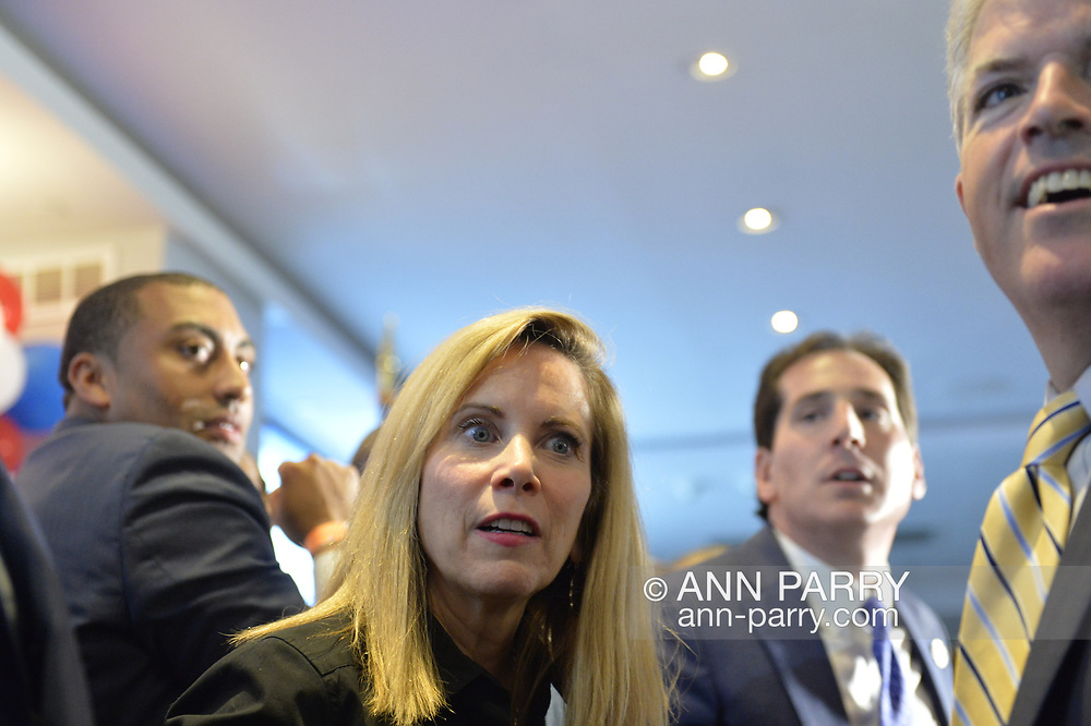 Garden City, New York, USA. November 6, 2018. Nassau County Democrats watch Election Day results at Garden City Hotel, Long Island. On stage were candidates who won election to the New York State Senate, including Senator TODD KAMINSKY re-elected to represent NYS SENATE SD9.  Plus other elected officials joined them, including Hempstead Town Supervisor LAURA GILLEN, and, at right, Suffolk County Executive STEVE BELLONE.