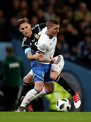 Argentina's Lucas Biglia (back) and Italy's Marco Verratti (right) battle for the ball